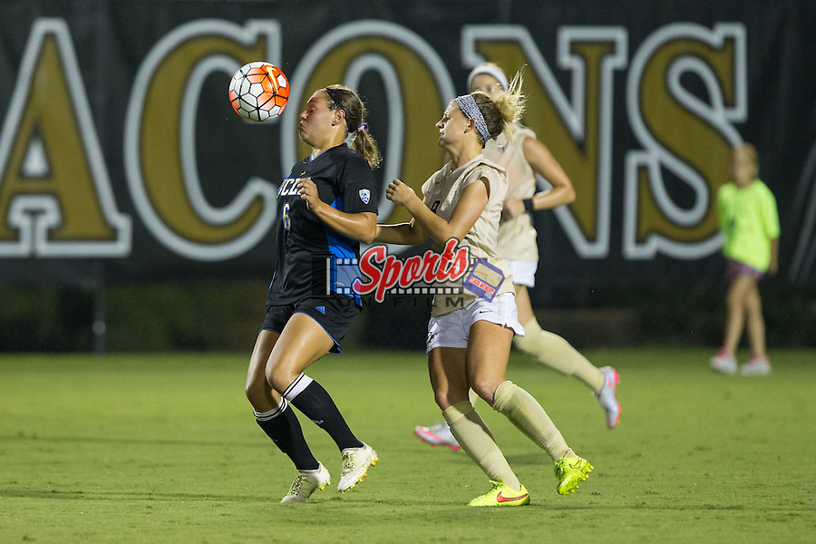 Lauren Kaskie (6) of the UCLA Bruins uses her body to keep the ball away from Bayley Feist (9) of the Wake Forest Demon Deacons during second half action at Spry Soccer Stadium on September 11, 2015 in Winston-Salem, North Carolina.  The Bruins defeated the Demon Deacons 2-1.  (Brian Westerholt/Sports On Film)