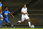 06 December 2014: North Carolina's Tyler Engel (8) and UCLA's Aaron Simmons (5). The University of California Los Angeles Bruins hosted the University of North Carolina Tar Heels at Drake Stadium in Los Angeles, California in a 2014 NCAA Division I Men's Soccer Tournament Quarterfinal round match. The game ended in a 3-3 tie after two overtimes. UCLA advanced to the next round by winning the penalty kick shootout 7-6.