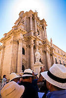 Tourists on a Syracuse City Tour outside The Temple of Athena (aka Syracuse Cathedral), Ortigia, Syracuse, UNESCO World Heritage Site, Sicily, Italy, Europe. This is a photo of tourists on a Syracuse City Tour outside The Temple of Athena (aka Syracuse Cathedral), Ortigia, Syracuse, UNESCO World Heritage Site, Sicily, Italy, Europe.