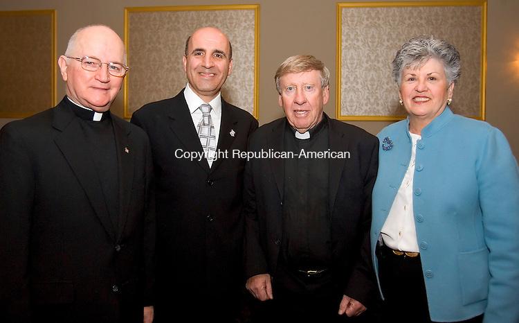 WATERBURY, CT--11 APRIL 2007--041107JS17-Rev. John Bevins of Immaculate Conception Church in Waterbury, Rep. Selim G. Noujaim, (R-74), Rev. Joseph Gorman (ret.) of St. Leo's Church in Waterbury and Deborah Cronin, President of Saint Mary's School Board, at the Bells of Saint Mary's annual awards dinner Wednesday at the Ponte Club in Waterbury. <br /> Jim Shannon / Republican-American