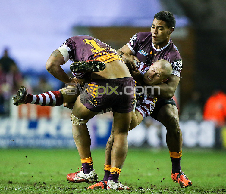 Picture by Alex Whitehead/SWpix.com - 21/02/2015 - Rugby League - World Club Series - Wigan Warriors v Brisbane Broncos - DW Stadium, Wigan, England - Wigan's Larne Patrick is tackled by Brisbane's James Gavet and Joe Ofahengaue.