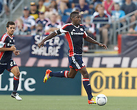 New England Revolution midfielder Clyde Simms (19) brings the ball forward. In a Major League Soccer (MLS) match, New England Revolution defeated New York Red Bulls, 2-0, at Gillette Stadium on July 8, 2012.