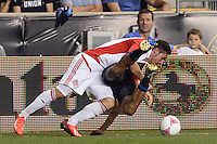 Alvaro Rey (23) of Toronto FC and Fabio Alves (Fabinho) (33) of the Philadelphia Union fall to the turf. The Philadelphia Union defeated Toronto FC 1-0 during a Major League Soccer (MLS) match at PPL Park in Chester, PA, on October 5, 2013.