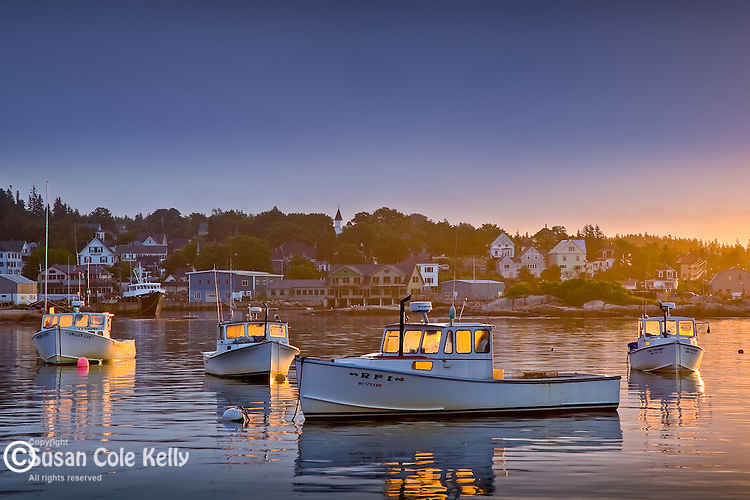 Sunrise lights lobster boats in Stonington, ME, USA