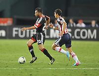 Carlos Ruiz (20) of D.C. United goes against Angel Zaldivar (33) of C.D. Guadalajara. C.D.Guadalajara tied D.C. United 1-1 during and international friendly, at RFK Stadium, Friday July 12, 2013.