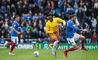 Gozie Ugwu of Wycombe Wanderers  turns Christian Burgess of Portsmouth during the Sky Bet League 2 match between Portsmouth and Wycombe Wanderers at Fratton Park, Portsmouth, England on 23 April 2016. Photo by Andy Rowland.