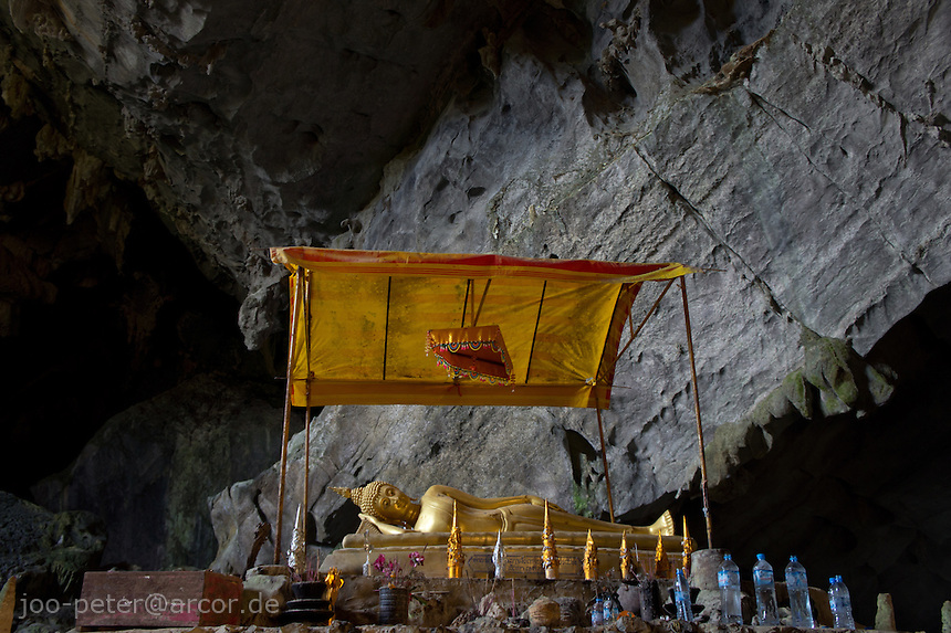 Buddha shrine in Poukham cave, close to Vang Vieng, Laos, 2012. The cave is also spelled  Tham Pu Kham or Tham Pou Kham in latin  letter writing, meaning cave of the golden crab. Like in many caves of  Laos, there is a buddhist shrine inside.