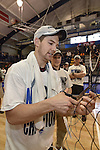 27 APR 2014: Nick Ferry of Springfield College cuts down the net  during the Division III Men's Volleyball Championship held at the Kennedy Sports Center in Huntingdon, PA. Springfield defeated Juniata 3-0 to win the national title.  Mark Selders/NCAA Photos
