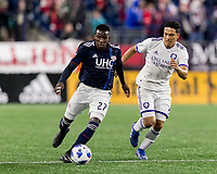 Foxborough, Massachusetts - October 13, 2018: First half action. In a Major League Soccer (MLS) match, New England Revolution (blue/white) vs Orlando City SC (white), at Gillette Stadium.