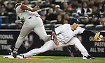 The Angels' Vladimir Guerrero, left, is called out at first base on a dropped third strike in the 4th inning during game two of the American League Championship Series at Yankee Stadium on Saturday, Oct. 17, 2009. Yankee's Mark Teixeira makes the stretch.