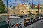 Boats on the Seine River, Paris, France. .  John offers private photo tours in Denver, Boulder and throughout Colorado, USA.  Year-round. .  John offers private photo tours in Denver, Boulder and throughout Colorado. Year-round.