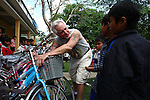 "Mark Oconnor interacts with local children while putting reflective tape on a new bicycle at a school in the rural highlands district of A Luoi in central Vietnam. In the past two years, Oconnor has given away nearly 150 bicycles to poor students in the mostly ethnic minority district so they can get to school easier. ""I just feel like the United States hasn't done enough to help these people since the war,"" said OConnor, 64, of Sioux Falls, S.D., who served in Vietnam from 1970 to 1971. ""And I just feel like I took more than I gave, so I'm giving back now."" April 8, 2015."