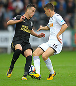 10th September 2017, Liberty Stadium, Swansea, Wales; EPL Premier League football, Swansea versus Newcastle United; Javier Manquillo of Newcastle United and Tom Carroll of Swansea City battle for possession during the match