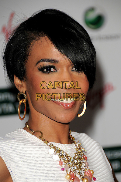 MICHELLE WILLIAMS .The WTA Tour Pre-Wimbledon Party,  Kensington Roof Gardens, London, England..June 18th, 2009.headshot portrait gold hoop earrings  white necklace .CAP/CAS.©Bob Cass/Capital Pictures.