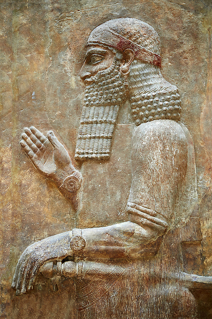 Stone relief sculptured panel of a dignitary . Facade L. Inv AO 19875 from Dur Sharrukin the palace of Assyrian king Sargon II at Khorsabad, 713-706 BC.  Louvre Museum Room 4 , Paris