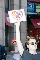 Counterprotesters hold signs toward, flip-off, and angrily shout at those marching in the Straight Pride Parade in Boston, Massachusetts, on Sat., August 31, 2019. The parade was organized in reaction to LGBTQ Pride month activities by an organization called Super Happy Fun America.