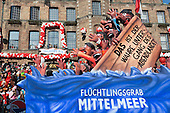 Düsseldorf, Germany. 16 February 2015. A float depicts refugees in a sinking ship on the Mediterranean.  The traditional Shrove Monday (Rosenmontag) carnival parade takes place in Düsseldorf, Germany. 1.2 million revellers lined the route. The Monday parades went ahead despite increased terror warnings which led to the parade in Brunswick (Braunschweig) being cancelled shortly before it was due to take place.