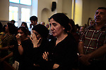 BAGHDAD, Iraq: 15th June 2014<br /> <br /> Congregation members during a church service in support of Iraq's Christians at the St. Georges Chaldean Church in the mainly Shiite suburb of New Baghdad. The Christian community in Iraq is as old as Christianity, but its adherents are facing an existential crisis. In Mosul, the Islamic State drove out Christians by demanding they either convert to Islam, pay a tax, leave the city or face death<br /> <br />  <br /> <br /> <br /> Fixer: Haider Kata +9647704425647<br /> <br /> Ayman Oghanna for National Geographic