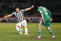 "Pictured: Sotiris Papagiannopoulos (L), when he played for PAOK Salonika in Greece. STOCK PICTURE<br /> Re: Swedish centre-back Sotiris Papagiannopoulos is joining Premier League side Swansea City for a trial.<br /> The 26-year-old is contracted to Swedish club Ostersunds FK, so could only sign for the Swans when the transfer window reopens in January.<br /> Swansea say Stockholm-born Papagiannopoulos will train with them for ""a few days"".<br /> The club have a working relationship with Ostersunds, having signed forward Modou Barrow from them in 2014."