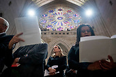 Members of the audience sing along with a song during the State Funeral for former President George H.W. Bush at the National Cathedral, Wednesday, Dec. 5, 2018,  in Washington. <br /> Credit: Andrew Harnik / Pool via CNP