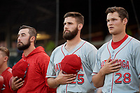 Chattanooga Lookouts x, Tejay Antone (25) and Brantley Bell (28) during the national anthem before a Southern League game against the Birmingham Barons on May 2, 2019 at Regions Field in Birmingham, Alabama.  Birmingham defeated Chattanooga 4-2.  (Mike Janes/Four Seam Images)
