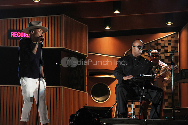 LOS ANGELES, CA - JANUARY 26: Stevie Wonder and Pharrell inside at The 56th Annual GRAMMY Awards at Staples Center on January 26, 2014 in Los Angeles, California. Photo Credit: Walik Goshorn/MediaPunch