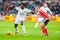 Bafetimbi Gomis of Swansea City  is held back during the Barclays Premier League match between Swansea City and Southampton  played at the Liberty Stadium, Swansea  on February 13th 2016