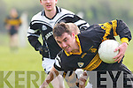Hands off. Austin Stack forward T J Hogan finds Ardfert midfielder Sean Flaherty trying to rip the ball from his grasp in their County League Division 1 clash in Ardfert on Sunday. .