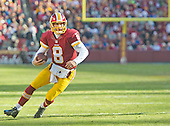 Washington Redskins quarterback Kirk Cousins (8) scrambles in second quarter action against the Buffalo Bills  at FedEx Field in Landover, Maryland on Sunday, December 20, 2015.  The result of the play was a touchdown.  The Redskins won the game 35-25.<br /> Credit: Ron Sachs / CNP