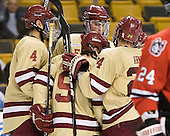 Tommy Cross (BC - 4), Barry Almeida (BC - 9), Brian Dumoulin (BC - 2), Bill Arnold (BC - 24) - The Boston College Eagles defeated the Northeastern University Huskies 7-1 in the opening round of the 2012 Beanpot on Monday, February 6, 2012, at TD Garden in Boston, Massachusetts.