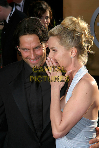 NIKOLAS SODERBLOM & NICOLlETTE SHERIDAN.Red Carpet Arrivals at the 11th Annual Screen Actors Guild Awards (SAG) held at the Shrine Auditorium, .Los Angeles, California, USA,.5th February 2005..half length couple fiance engagement ring finger hand over mouth whispering Nicolette.Ref: ADM.www.capitalpictures.com.sales@capitalpictures.com.©J.Wong/AdMedia/Capital Pictures .