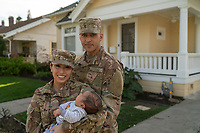 Army soldier father with his family at outside home, stock photo, DOD complient, rights managed, model released