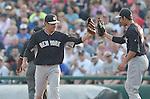 (L-R) Masahiro Tanaka, Garrett Jones (Yankees),<br /> MARCH 18, 2015 - MLB :<br /> Masahiro Tanaka and Garrett Jones of the New York Yankees touch gloves during a spring training baseball game against the Atlanta Braves in Lake Buena Vista, Florida, United States. (Photo by AFLO)