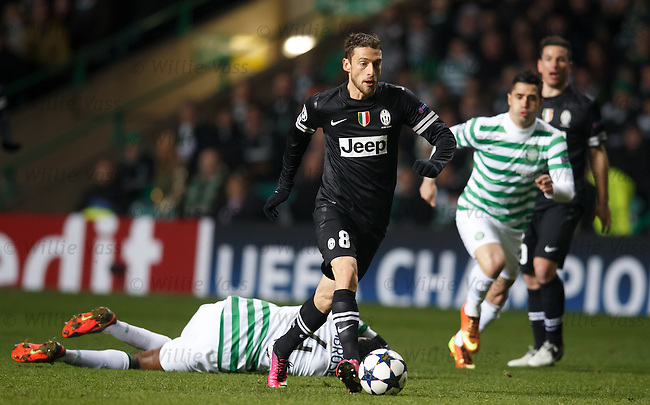 Claudio Marchisio strolls by Efe Ambrose to set up the ball for Mirko Vucinic's goal