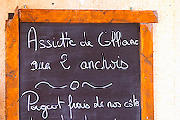 Restaurant menu: Collioure special: 2 kinds of anchovies. Collioure. Roussillon. France. Europe.