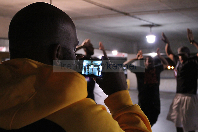 Omega Phi Psi fraternity practices for the University of Kentucky Homecoming Step Show on Monday, Oct. 17, 2011 in Lexington, Ky. They practiced in an empty parking garage.  Photo by Latara Appleby | Staff ..