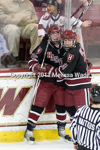 Katharine Chute (Harvard - 15) and Kate Buesser (Harvard - 20) celebrate Chute's goal which tied the game just 36 seconds after BC scored. - The Boston College Eagles defeated the Harvard University Crimson 3-1 to win the 2011 Beanpot championship on Tuesday, February 15, 2011, at Conte Forum in Chestnut Hill, Massachusetts.