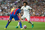 Marcelo Vieira of Real Madrid competes for the ball with Sergio Busquets of FC Barcelona during the match of La Liga between Real Madrid and Futbol Club Barcelona at Santiago Bernabeu Stadium  in Madrid, Spain. April 23, 2017. (ALTERPHOTOS)
