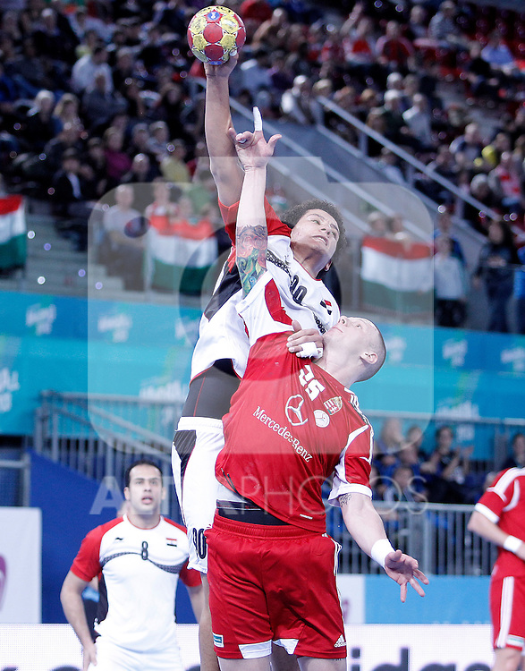 Hungary's Szabolcs Zubai (d) and Egypt's Ali Zein during 23rd Men's Handball World Championship preliminary round match.January 12 ,2013. (ALTERPHOTOS/Acero)