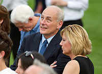 United States Secretary of Homeland Security John F. Kelly listens as US President Donald J. Trump makes remarks as the President and first lady Melania Trump host the annual Congressional Picnic on the South Lawn of the White House in Washington, DC on Thursday, June 22, 2017.<br /> Credit: Ron Sachs / CNP /MediaPunch