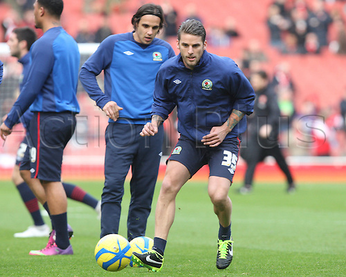 16.02.2013. London, England. David Bentley of Blackburn Rovers (on loan from Tottenham Hotspur) behind Karim Rekik of Blackburn Rovers(on loan from Manchester City) before The FA Cup Fifth Round game between Arsenal and Blackburn Rovers from Emirates Stadium