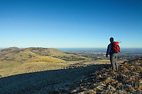 A walker looking towards Castle Law and Allermiur Hill from Turnhouse Hill, The Pentland Hills, Edinburgh, Lothian<br /> <br /> Copyright www.scottishhorizons.co.uk/Keith Fergus 2011 All Rights Reserved.