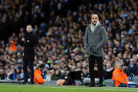 Manchester City manager Josep Guardiola (right) and FC Schalke 04 manager Domenico Tedesco watch on from their technical areas<br /> <br /> Photographer Rich Linley/CameraSport<br /> <br /> UEFA Champions League Round of 16 Second Leg - Manchester City v FC Schalke 04 - Tuesday 12th March 2019 - The Etihad - Manchester<br />  <br /> World Copyright © 2018 CameraSport. All rights reserved. 43 Linden Ave. Countesthorpe. Leicester. England. LE8 5PG - Tel: +44 (0) 116 277 4147 - admin@camerasport.com - www.camerasport.com