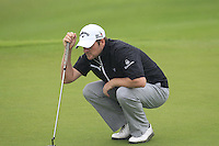 Marc Warren (SCO) on the 1st green during Thursday's Round 1 of the 2014 BMW Masters held at Lake Malaren, Shanghai, China 30th October 2014.<br /> Picture: Eoin Clarke www.golffile.ie