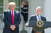 United States EPA Administrator Scott Pruitt makes a statement after US President Donald J. Trump made a statement  regarding the Paris Accord in the Rose Garden of the White House in Washington, DC on Thursday, June 1, 2017.  The President announced the US will withdraw from the accord.<br /> Credit: Ron Sachs / CNP