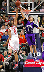 Northwestern's Drew Crawford (1) blocks the shot of Ohio State forward Jared Sullinger (0) in the Big Ten Men's Basketball Tournament in Indianapolis, IN on March 11, 2011.  (Photo by Bob Campbell)
