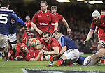 Wales captain Sam Warburton dives over to score despite the efforts of French prop Nicolas Mas to stop him.<br /> RBS 6 Nations 2014<br /> Wales v France<br /> Millennium Stadium<br /> 21.02.14<br /> <br /> &copy;Steve Pope-SPORTINGWALES