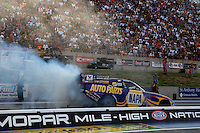 Jul. 19, 2013; Morrison, CO, USA: NHRA funny car driver Ron Capps during qualifying for the Mile High Nationals at Bandimere Speedway. Mandatory Credit: Mark J. Rebilas-