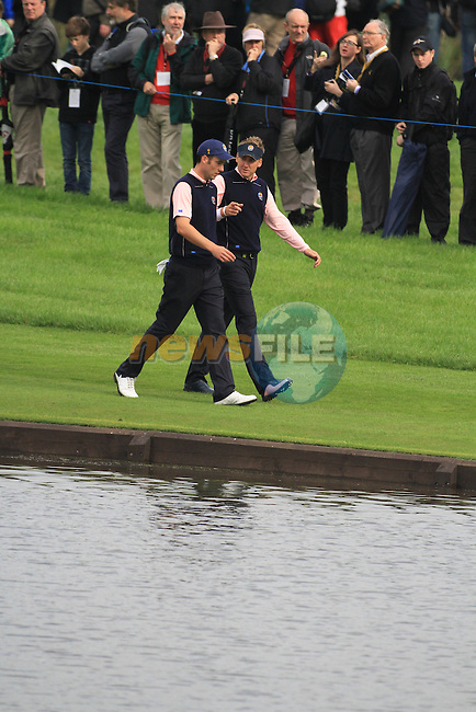2010 Ryder Cup at the Celtic Manor twenty ten course, Newport Wales, 30/9/2010 Practice Day 3..Ross Fisher and Ian Poulter walk the 13th fairway..Picture Fran Caffrey/www.golffile.ie.