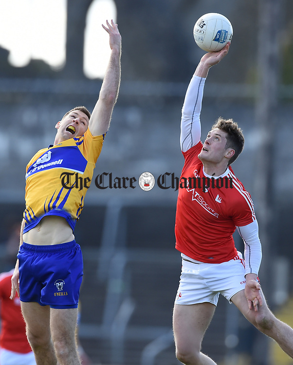 Gary Brennan of Clare in action against Declan Byrne of Louth during their national League game in Cusack Park. Photograph by John Kelly.